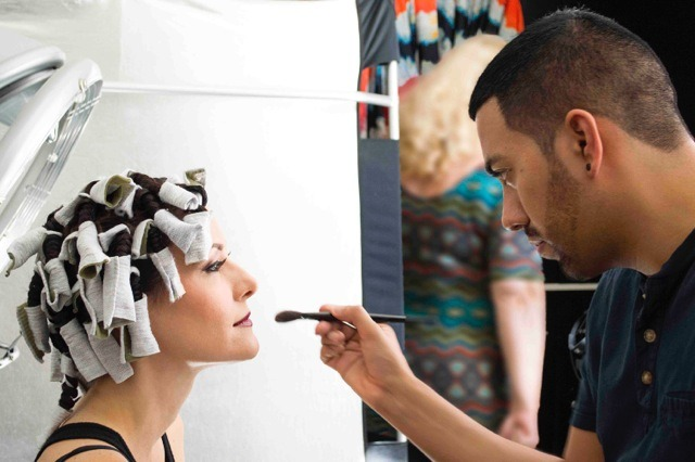 Make-Up Artist Daniel Chinchilla prepping model Jacqueline Depaul with rag curlers